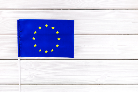 Independence Day of European Union concept with flag on white wooden background top view