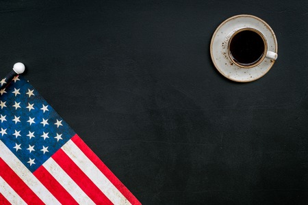 Memorial day of United States of America with flag and coffee on black background top view mock up