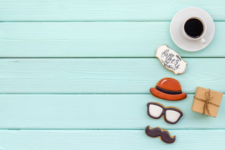 Moustache, hat, glasses, coffee, gift and copy for Happy Father Day party on mint green background top view copy space Stock Photo