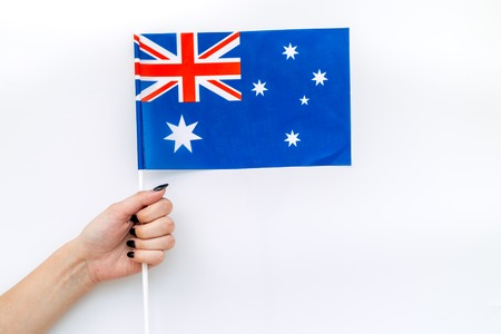 Flag of Australia in hand on white background top view Banco de Imagens