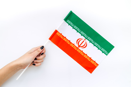 National day of Iran concept with flag in hand on white background top view Stok Fotoğraf