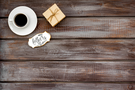 Happy Father Day with gift and coffee on wooden background top view mockup