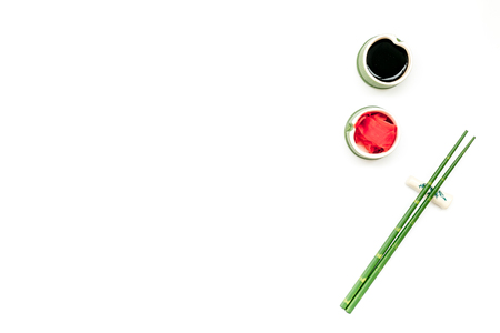 bamboo sticks, soy sauce, ginger for sushi and maki on white background top view mockup