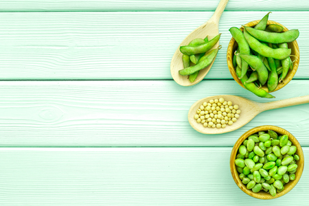 Green soybeans background on mint green wooden desk top view mockup