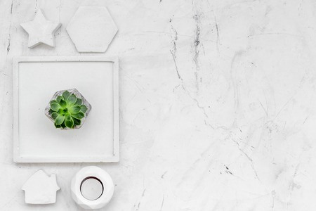 plant, candle, concrete figures and tray decorations for morden home office on marble background flat lay mock up Zdjęcie Seryjne