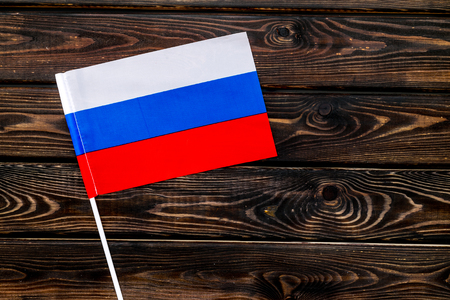 Flag of Russia on wooden background top view.