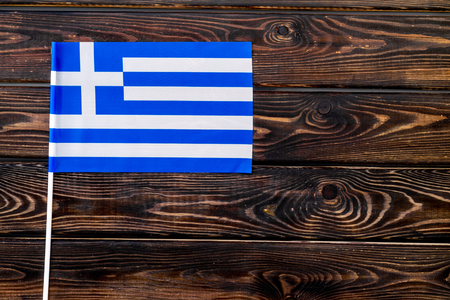 Independence Day of Greece concept with flag on wooden background top view.