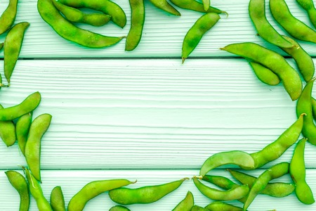 Ingredients. Green soybeans or edamame for fresh healthy organic food frame on mint green wooden background top view space for text Stock Photo