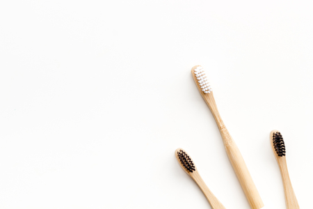 Bamboo dental cleaning brush for zero waste lifestyle concept and care for teeth on white background top view mock up Stok Fotoğraf