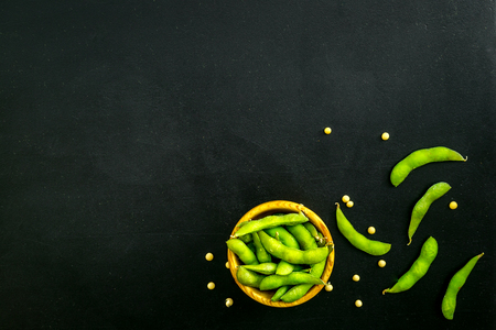 Ingredients. Green soybeans or edamame for fresh healthy organic food on black background top view space for text
