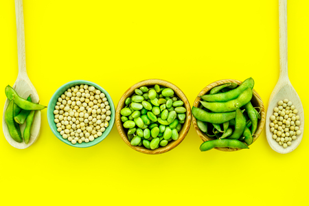 Healthy food. Edamame in bowl and spoon on yellow background top view Stock Photo