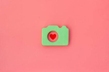 Photo camera concept on pink background top view mock up.