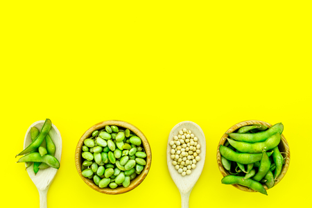 Healthy food. Edamame in bowl and spoon on yellow background top view mock up