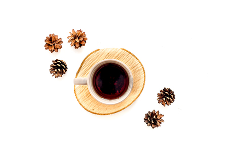Wooden sawcut. Cup of coffee, wooden stumps and pine cones for blog background on white background top view space for text