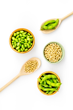 Ingredients. Green soybeans or edamame in spoon and bowl for fresh healthy organic food on white background top view