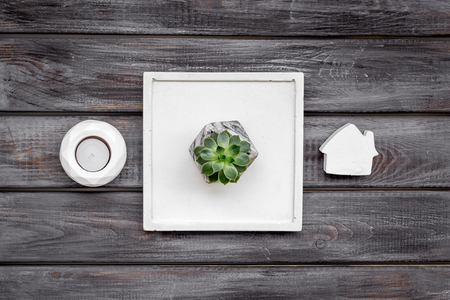 Home office. Work desk design with concrete decorations, candle and plant on wooden background top view 版權商用圖片