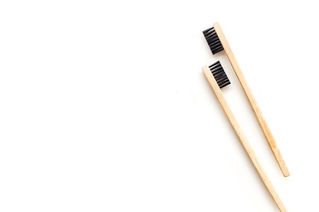 Bamboo dental cleaning brush for zero waste lifestyle concept and care for teeth on white background top view mock up Stock Photo