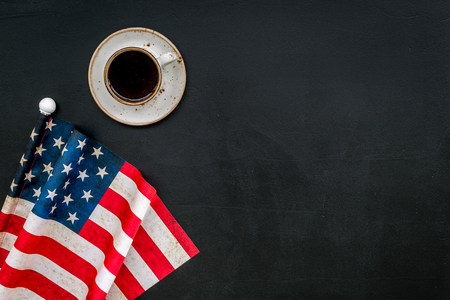 Symbol of Independence day of USA concept with flag cup of coffee on black background top view space for text
