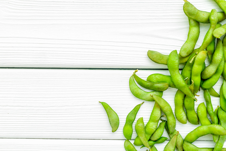 Sport diet food with green soybeans background on white wooden desk top view mockup
