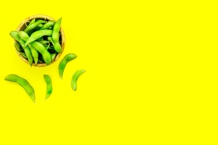 Sport diet food with green soybeans background on yellow desk top view mockup Stock Photo