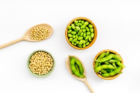 Sport diet food with green soybeans background on white desk top view