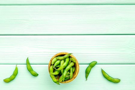 Ingredients. Green soybeans or edamame for fresh healthy organic food on mint green wooden background top view space for text