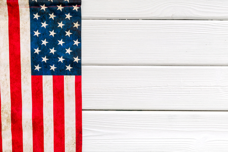 Symbol of Independence and Memorial day of United States of America with flag on white wooden background top view mock up