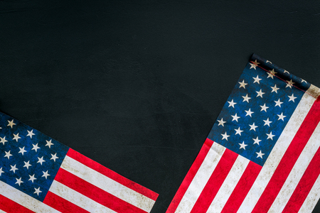 Symbol of Independence and Memorial day of United States of America with flag on black background top view mock up