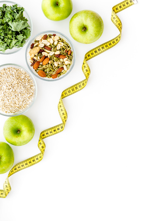 Proper nutrition. Weight loss concept with green organic food on white background top view space for text