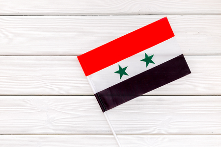 Flag of Syria on white wooden background top view. Banco de Imagens
