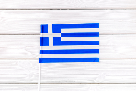 Independence Day of Greece an concept with flag on white wooden background top view.