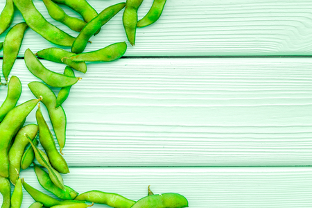 Healthy food. Edamame on mint green wooden background top view mock up