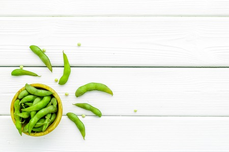 Ingredients. Green soybeans or edamame for fresh healthy organic food on white wooden background top view space for text Stock Photo