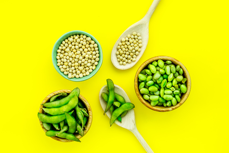 Vegan food concept with green soybeans or edamame on yellow desk background top view Stock Photo