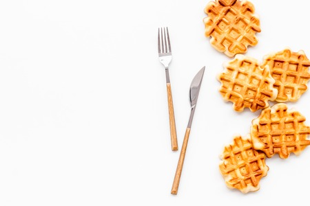Hot homemade breakfast. Traditional Belgian waffles on served wooden table background top view mockup