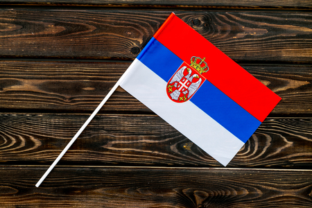Independence Day of Serbia concept with flag on wooden background top view.