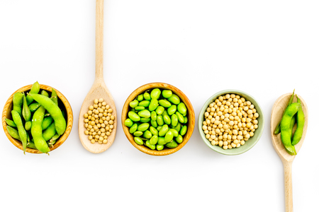 Healthy food. Edamame in bowl and spoon on white background top view