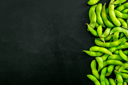 Sport diet food with green soybeans background on black desk top view mockup Stock Photo