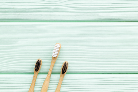 Dental care. Eco materials concept with bamboo tooth brush on mint green wooden background top view copy space Stock fotó