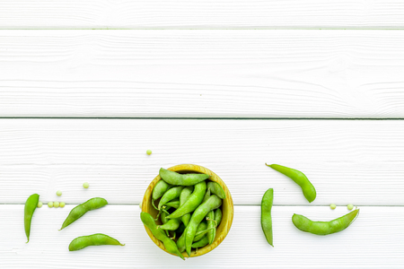 Healthy food. Edamame in bowl on white wooden background top view mock up