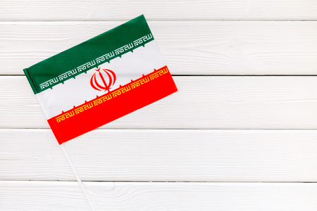 Independence Day of Iran concept with flag on white wooden background top view.