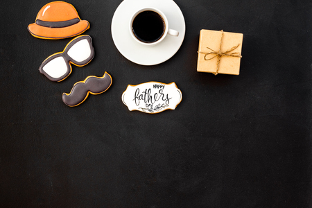 Happy Father Day celebration with hat, glasses, moustache cookies, gift and coffee on white background top view mockup