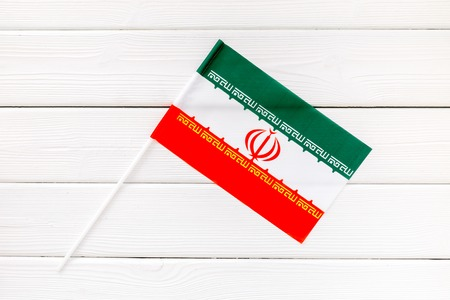 Flag of Iran on white wooden background top view.