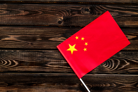 Independence Day of China concept with flag on wooden background top view.