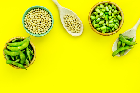 Edamame in bowl and spoon on yellow background top view mock up Stock Photo