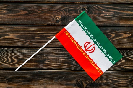 Flag of Iran on wooden background top view.
