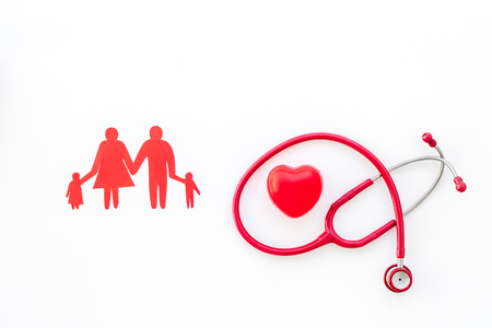 Family doctor. Cardiologist. Diagnostic and cure of cardiac disease with stethoscope and family paper figures on white background top view mock-up Imagens