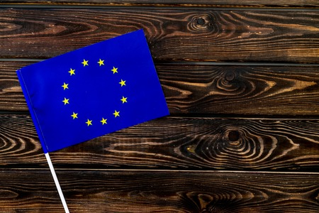 Symbol of the national day of European Union concept with flag on wooden background top view