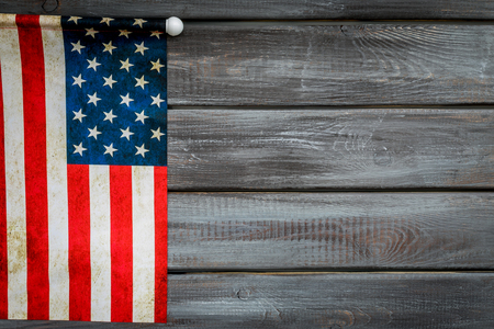 Symbol of Independence and Memorial day of United States of America with flag on gray wooden background top view mock up Reklamní fotografie