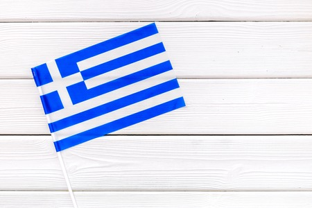 National day of Greece concept with flag on white wooden background top view
